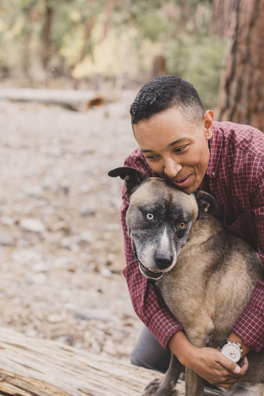 dad hugs dogs during Las Vegas family photos