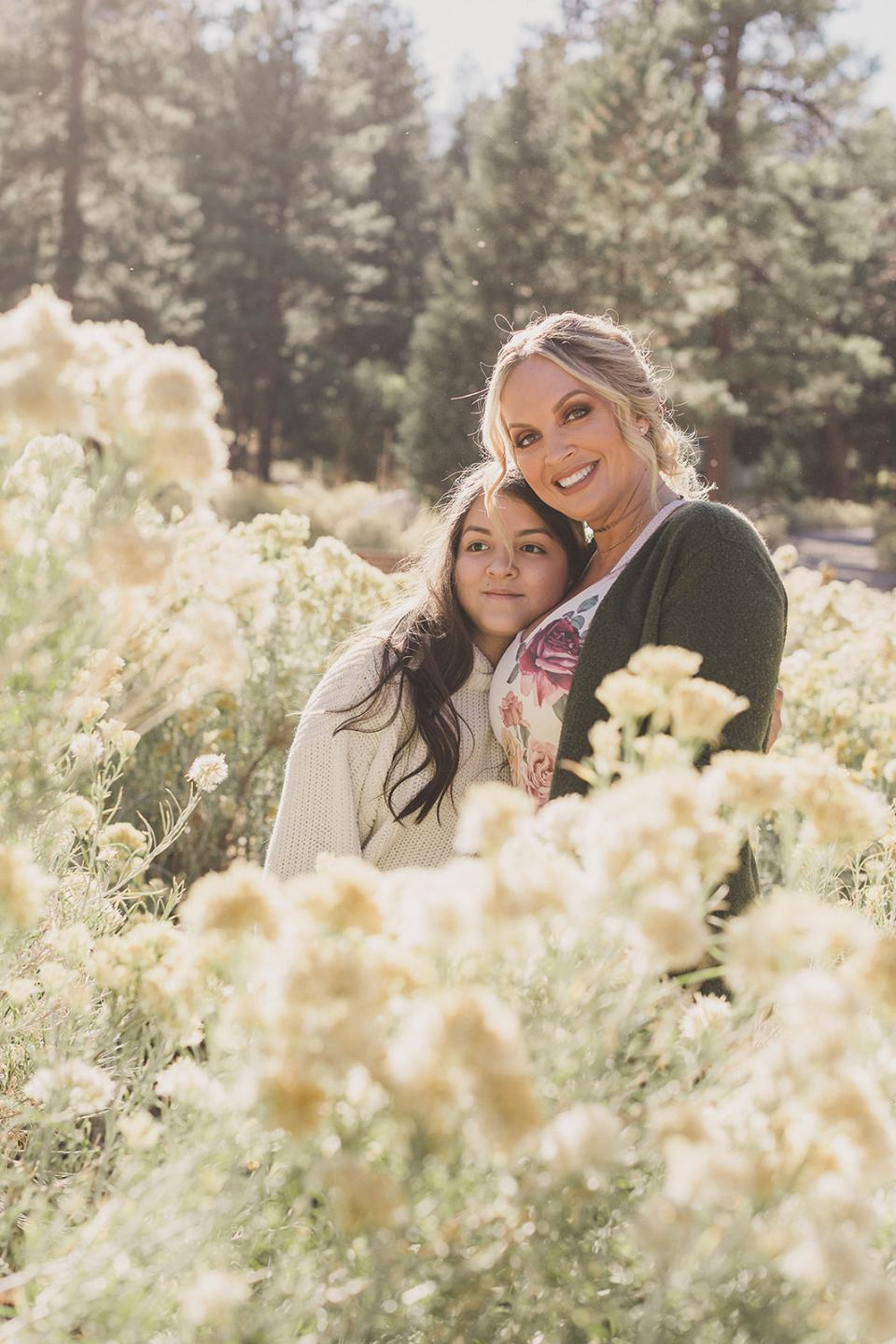 mom and daughter pose near bush in Kyle Canyon