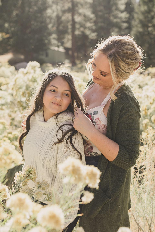mom brushes daughter's hair during Las Vegas family photos