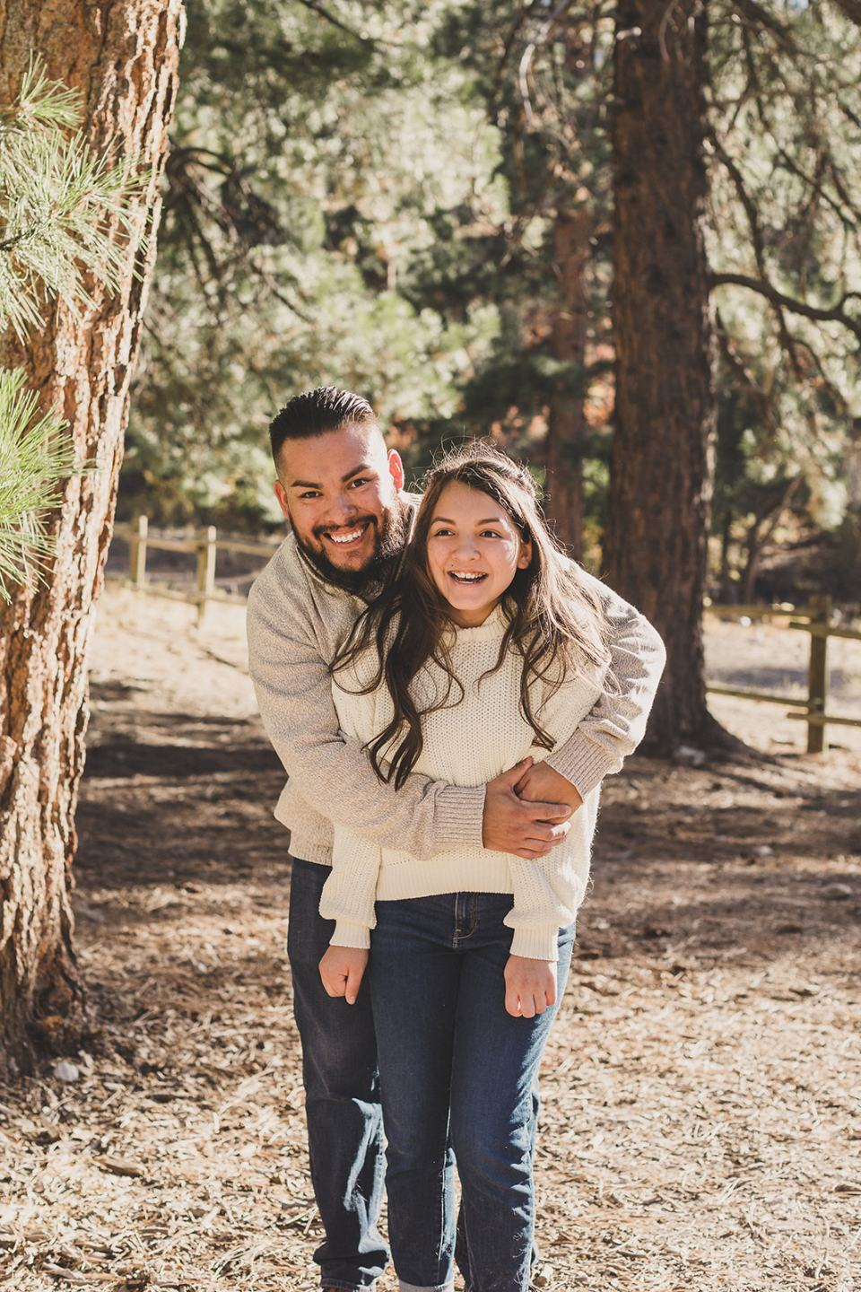 dad and daughter hug during Mt Charleston Family Portraits