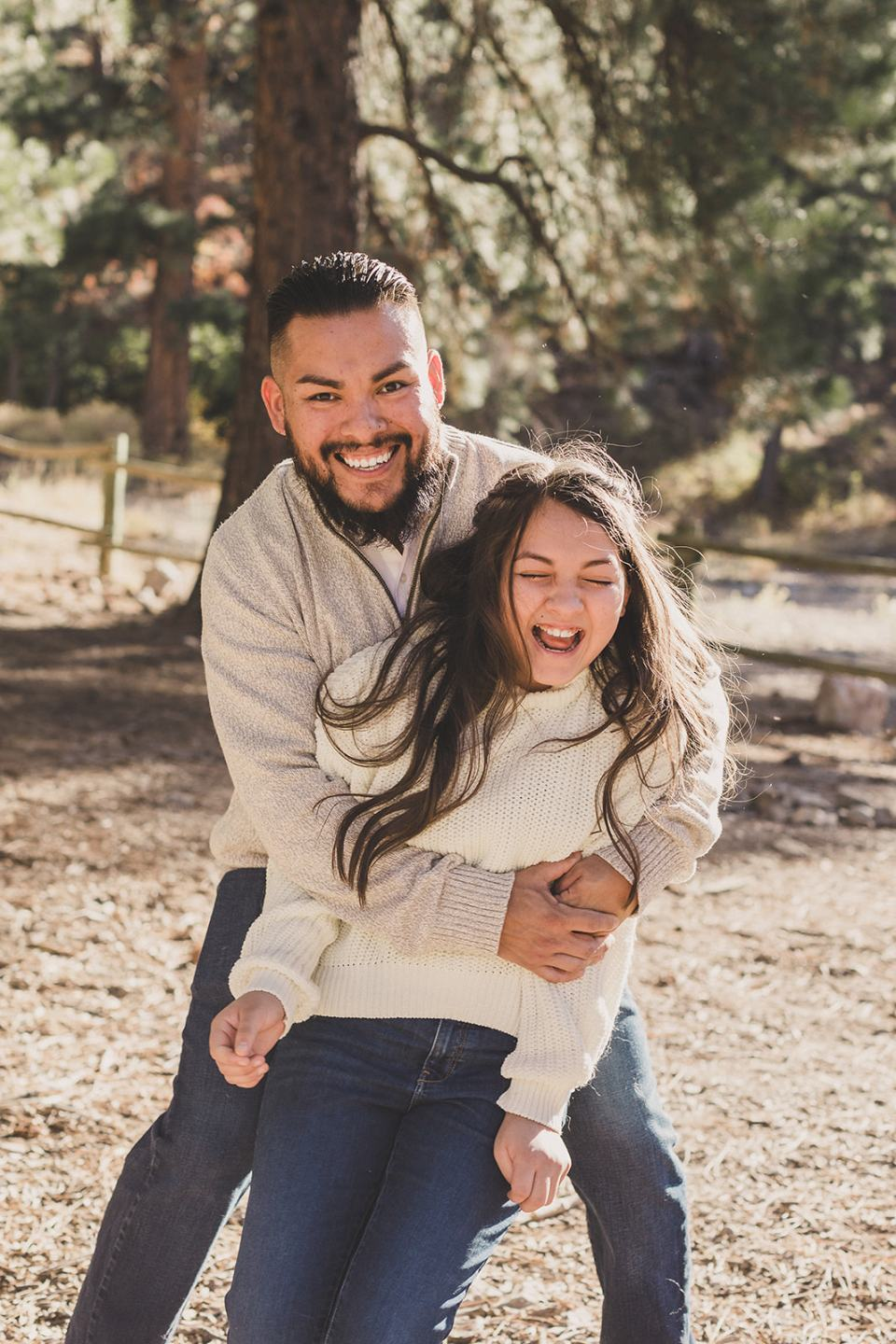 dad hugs daughter making her laugh during Mt Charleston Family Portraits