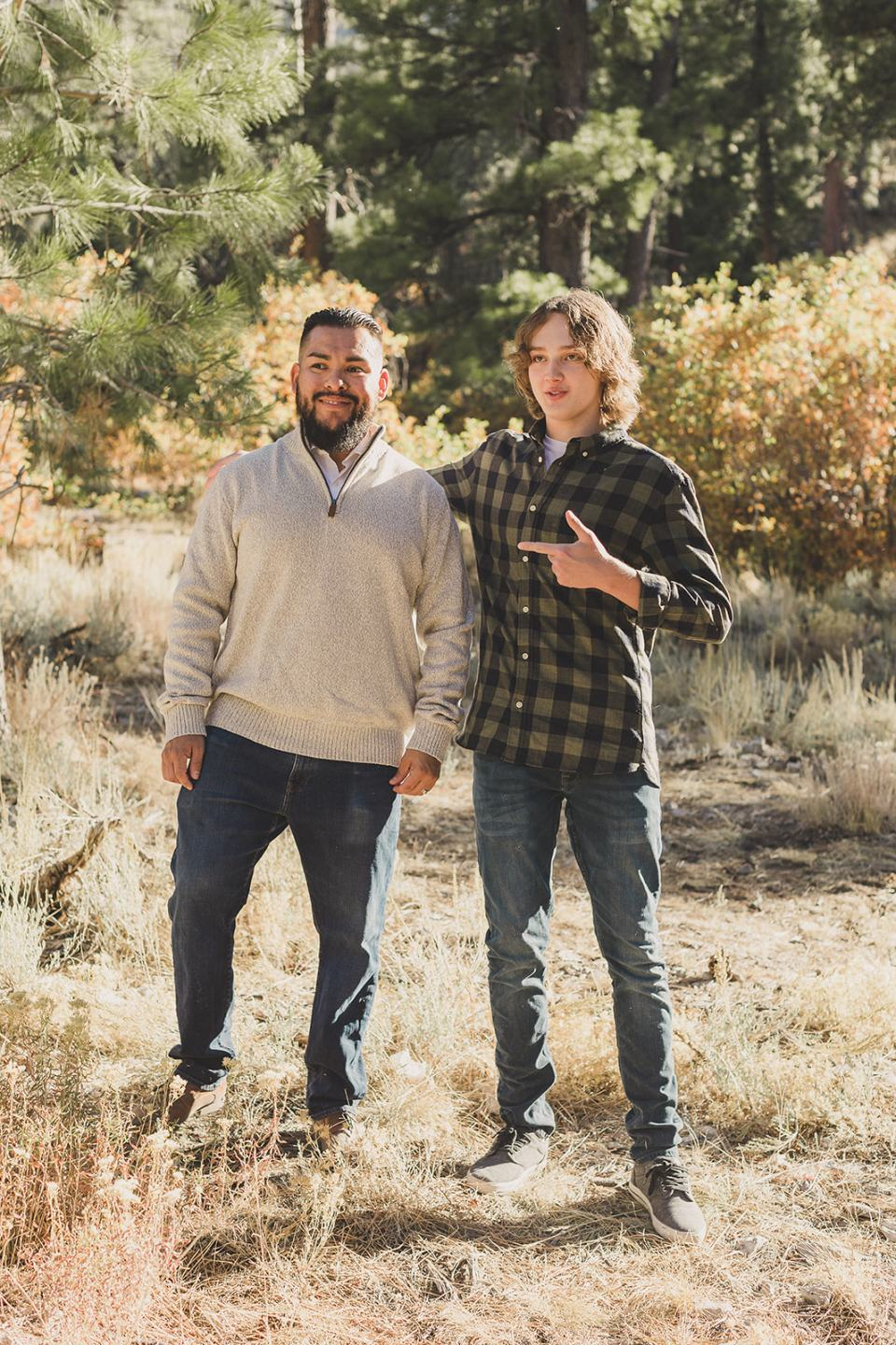 son points to dad during Mt Charleston Family Portraits