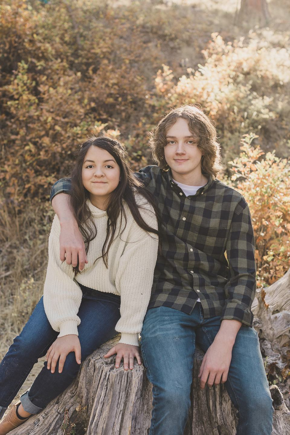 brother hugs sister during family photos
