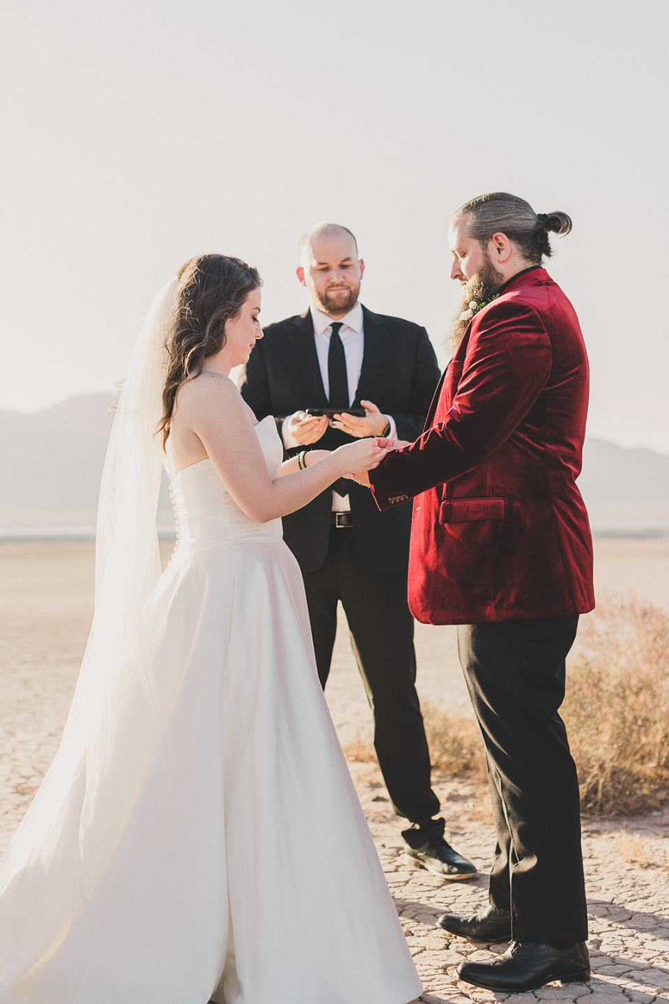 bride and groom exchange vows in Las Vegas desert