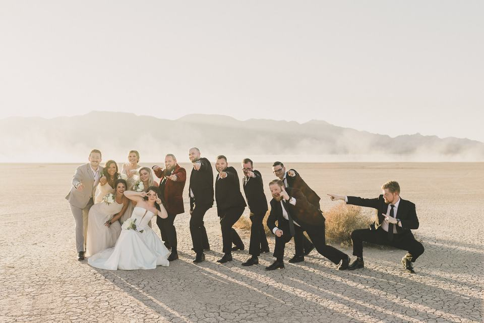 bride and groom pose with bridal party after microwedding
