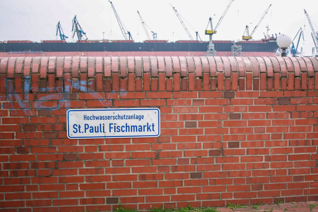 A brick wall and the St. Pauli Fischmarkt sign in Hamburg, Germany