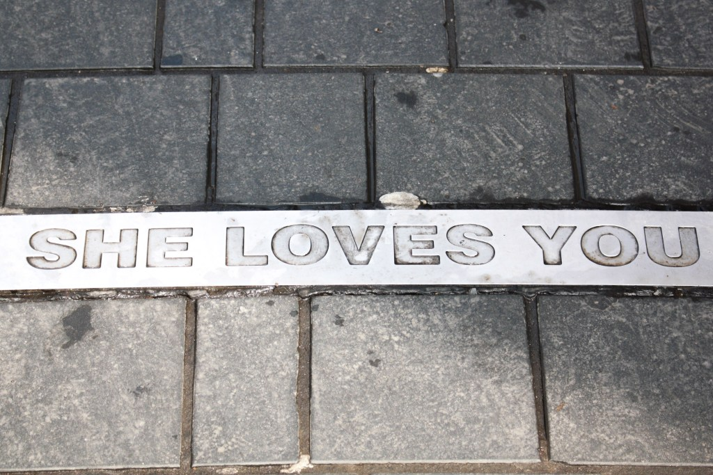 """She Loves You"" inscribed in the pavement at Beatles Platz in Hamburg, Germany"
