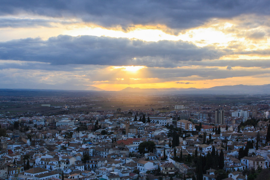 The view of Granada, Spain from the Sacromonte Caves at sunset.