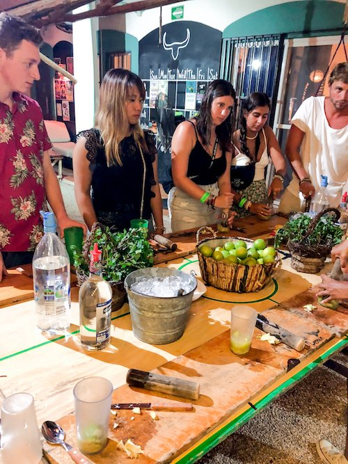 Five people make mojitos around a table in playa del carmen, Mexico