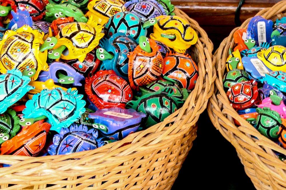 buckets of multi-colored turtle figurines in playa del carmen