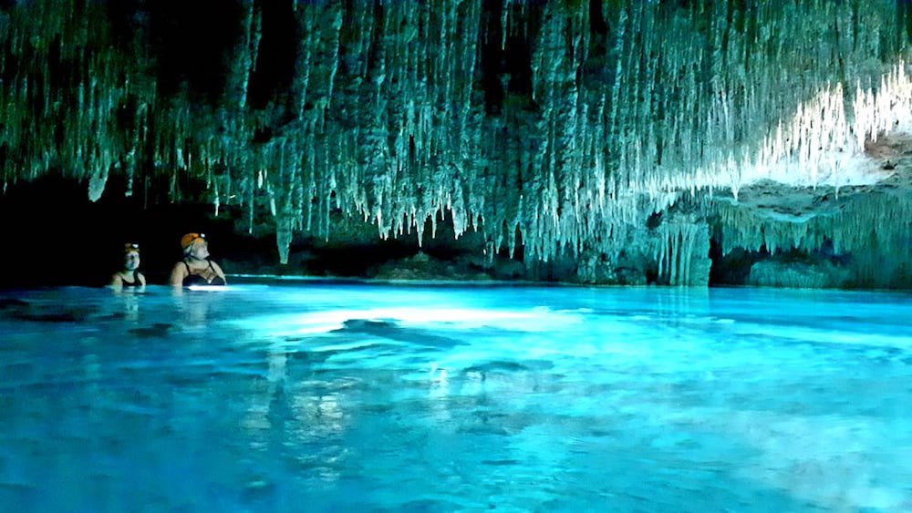 a cave in playa del carmen mexico with stalagmites and stalactites