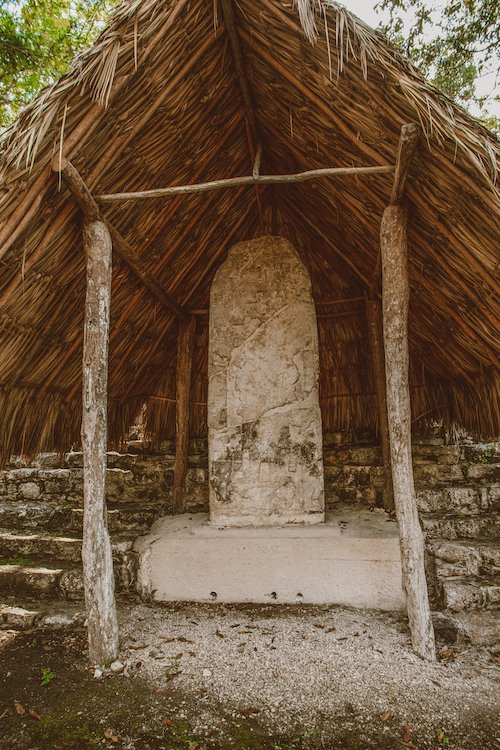 A straw building and a shrine at the Coba Ruins in Mexico