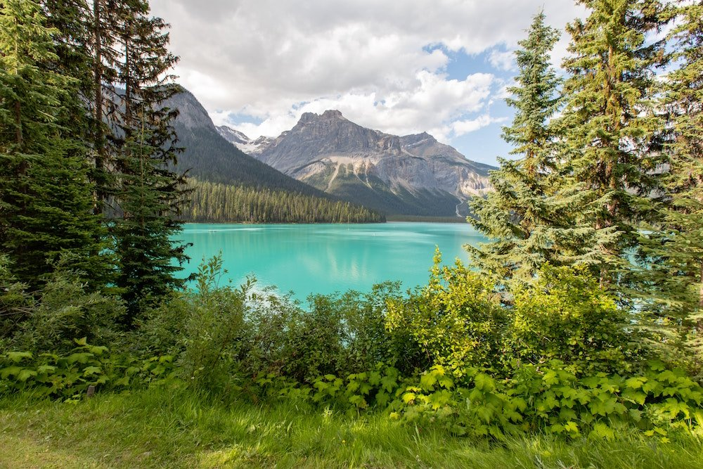 Emerald Lake sits among towering mountains in Crowsnest Pass, Alberta