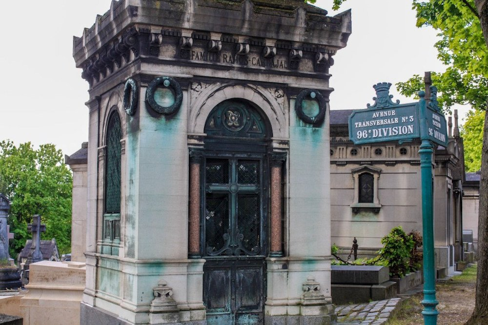 An old mausoleum in Pere Lachaise Cemetery in Paris France, near the 96 Division
