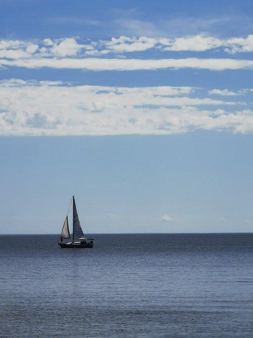 A sailboat in the waters of Lake Winnipeg near Gimli, Manitoba