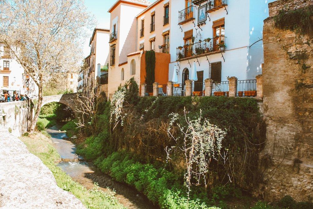 The Darro River and buildings in Granada, Spain