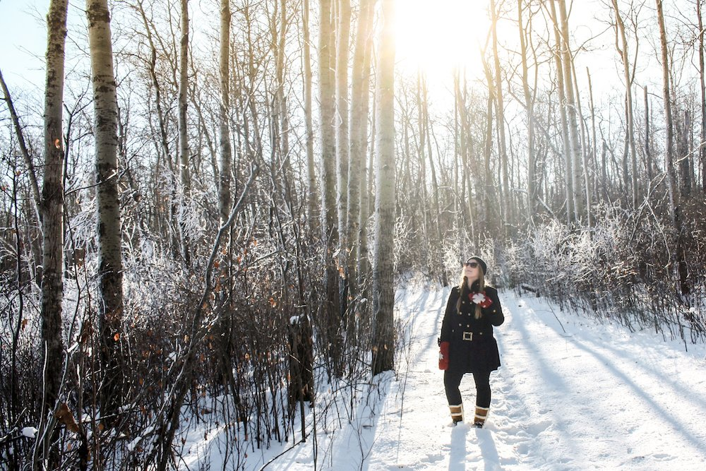 Taylor stands in the snow among frosted trees in Kenosee Lake, Saskatchewan