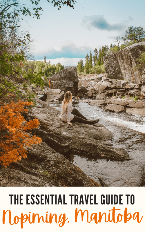 Taylor sits on a rock looking out over Tulabi Falls in Nopiming Provincial Park, Manitoba