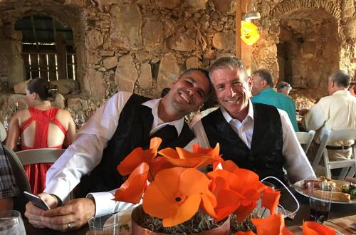 At our wedding reception with orange poppies