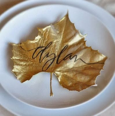 Leaves sprayed gold as place cards