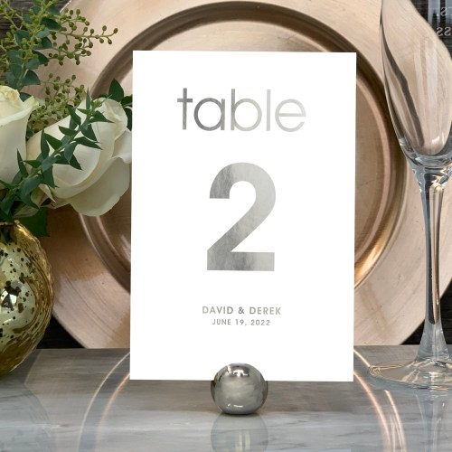 Our Modern Wedding Table Numbers are shown here in silver foil.