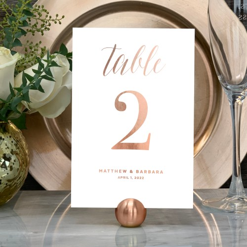 Our Traditional Wedding Table Numbers are shown here in rose gold foil.