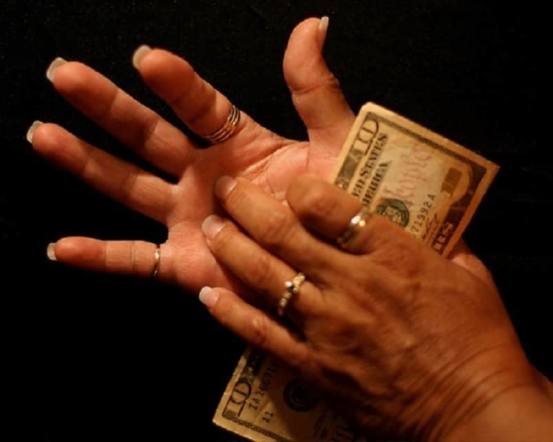 Itchies left or right palm - signs for money and wealth