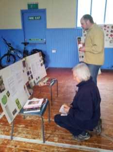 Participants reading the display boards