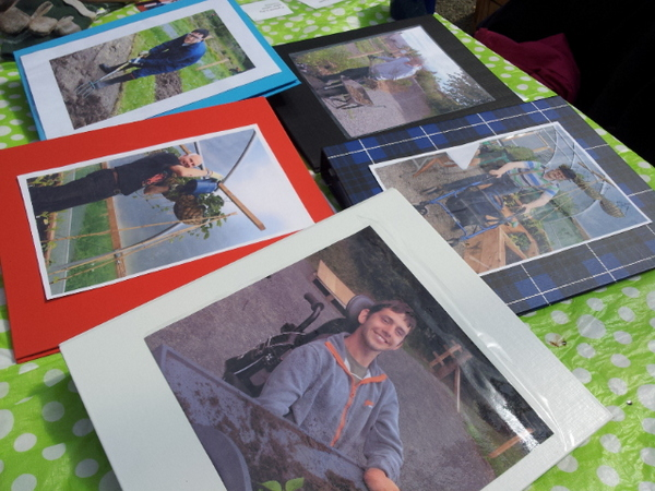 Binders with people's photos on the cover