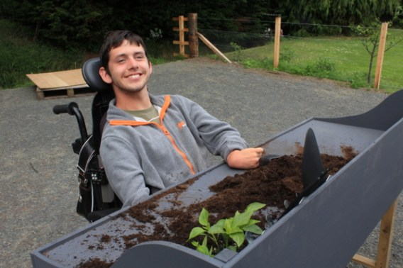 A man in a wheelchair at a potting bench