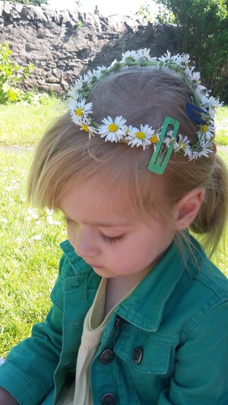 A photo of Nina in a daisy chain