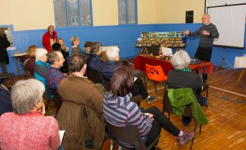 A photo of an audience listening to John Marshall's tattie stories