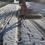 A photo of a girl walking in snow in Tayport