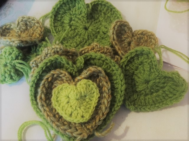 A photo of Green Valentine's crochet hearts for #showthelove