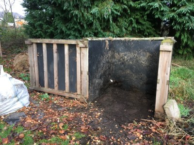 Compost bins with rotten down compost