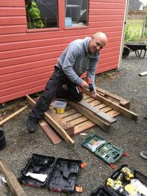 Graeme building the pallet garden
