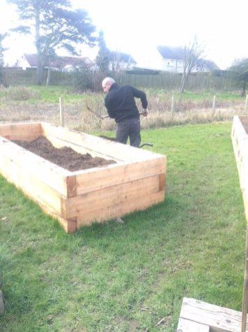 Photo of Craig filling raised beds
