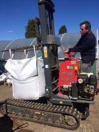Peter transporting top soil to fill raised beds