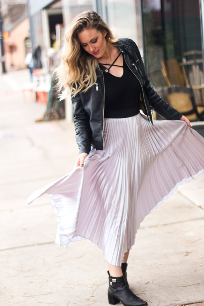 pleated, metallic skirt, leather jacket, bodysuit, criss cross top