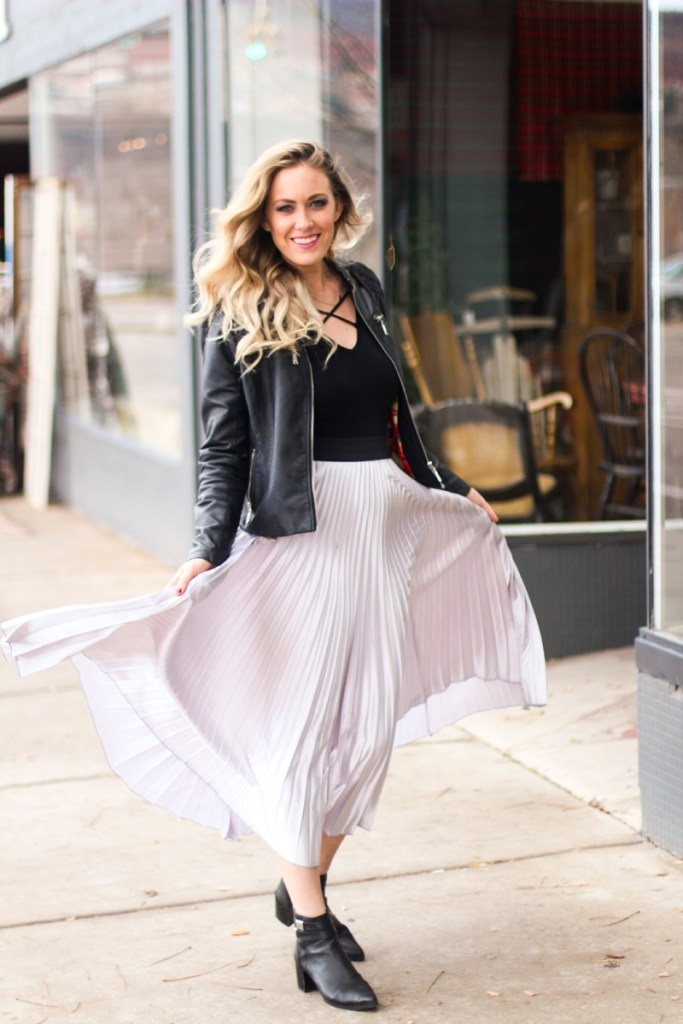 pleated metallic skirt, bodysuit, leather jacket