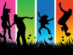 youth jumping rainbow background