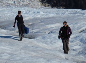 Student researchers carry equipment across the surface of the Taku Glacier, in Alaska.