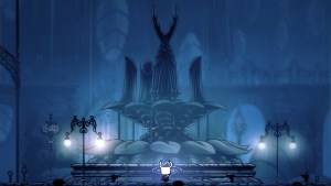 """""""Hollow Knight"""" before the memorial statue."""
