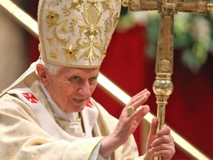 Pope Benedict XVI waves as he leaves St. Peter's Basilica