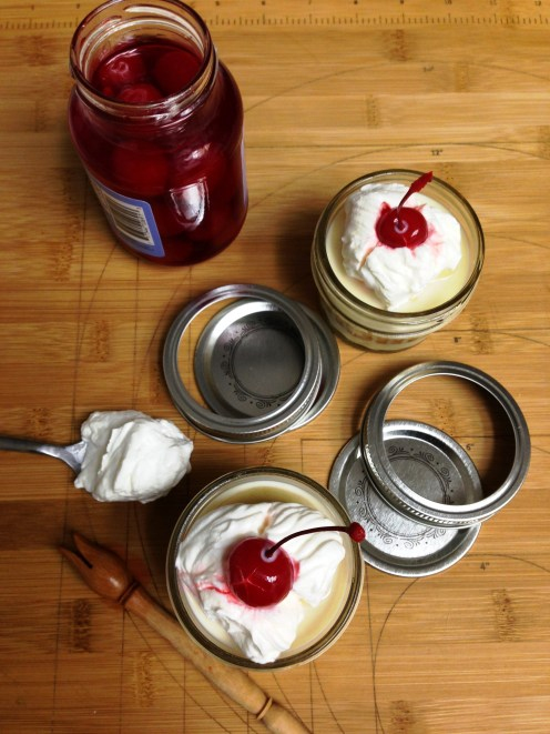 Tres Leches Cakes topped with Whipped Cream and Maraschino Cherries