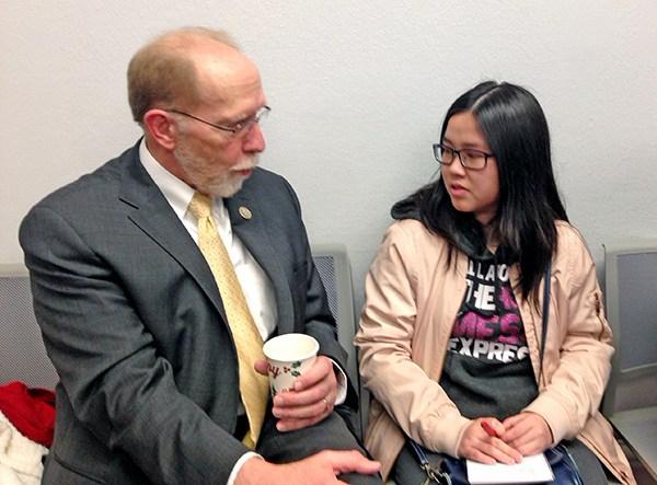 Iowa Congressman Dave Loebsack visits with SCC student Thu Nguyen.