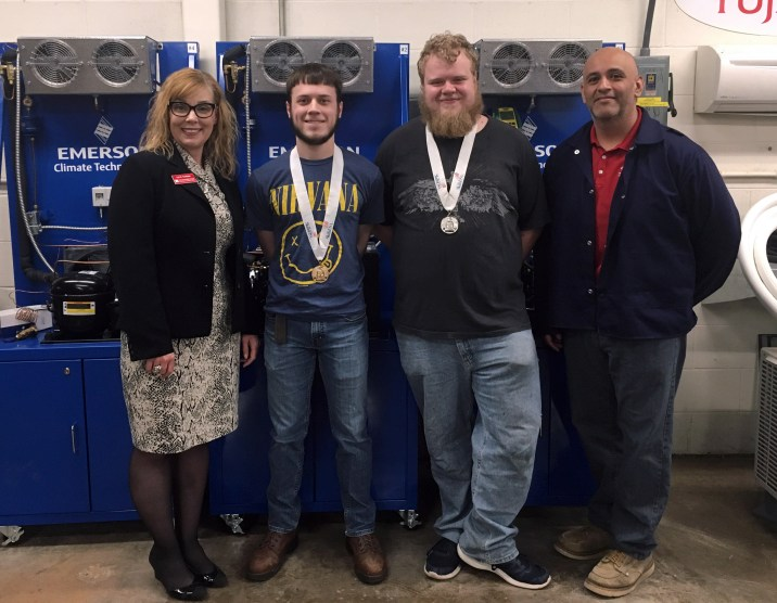 SCC President Lyn Cochran standing with winnders Brennan Kearney, Brock Deschepper and HVAC instructor Zeke Gonzalez