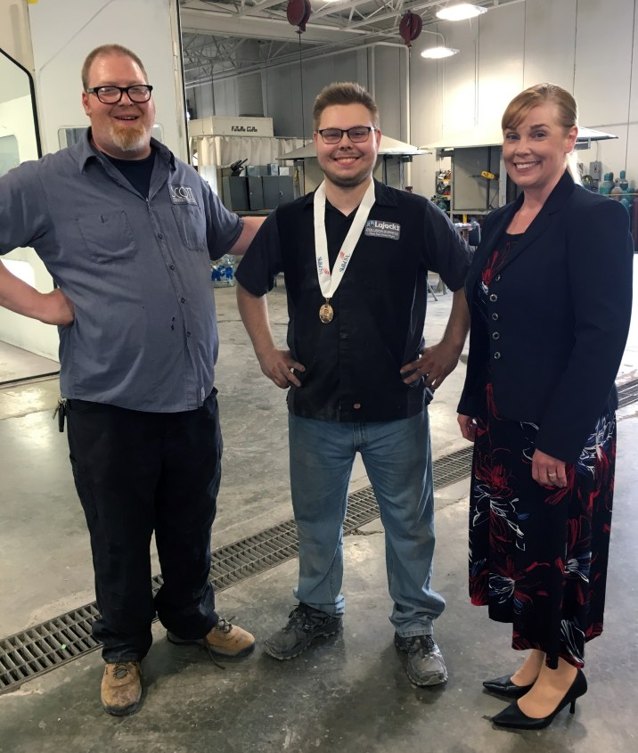 Instructor Ed Valle, standing with SKILLS USA Winner Matthew Speidel and SCC President Lyn Cochran