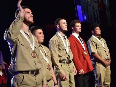 Brennan Kearney Accepting Gold Medal at SKILLS USA