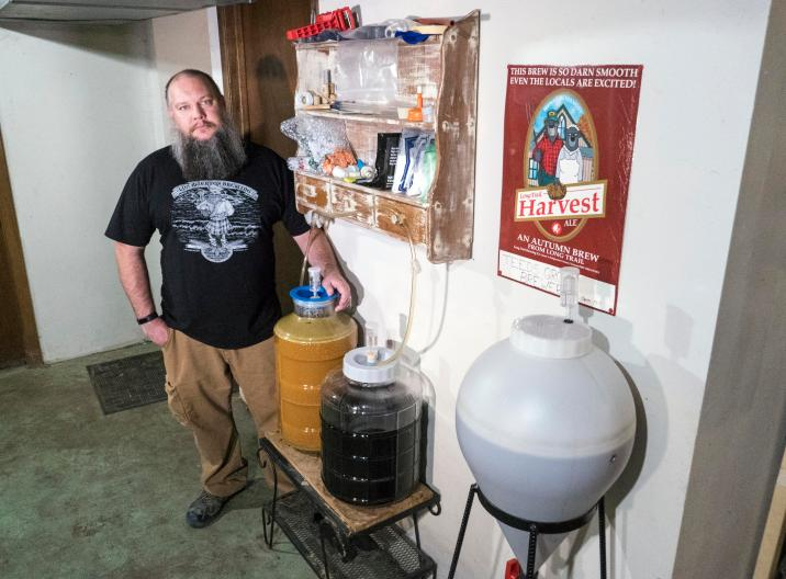 Instructor Ryan Welch with his home brewing equipment